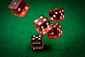 Rolling dice GettyImages 93453966 58a6f50c3df78c345b634f6f